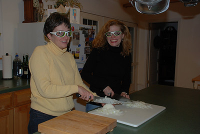 Goggle girls chopping onions