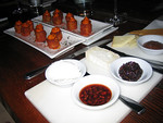 Cheese plate and patatas bravas at Amada