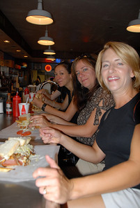 Seated at the counter of Primanti Bros. - Marilee, Jen, Nickie and Ann's arm
