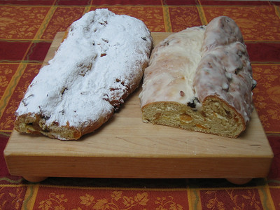 Stollen dusted with powdered sugar and iced