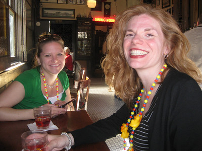 Emily and Kathy laughing over their Sazeracs