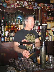 Mike pouring Guinness at the Kerry