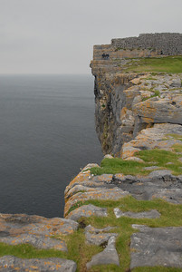 Cliff, Dun Aenghus and two brave -- or insane -- guys sitting near the edge